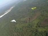 Stock Video Footage of Hang Glider Being Towed by Plane and then Released