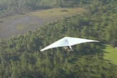 Aerial Zoom In of Hang Glider in Flight Stock Footage