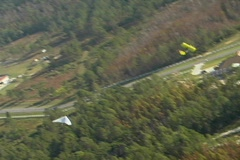 Aerial Wide Shot of Hang Glider Being Towed By an Ultra-light Plane Stock Footage