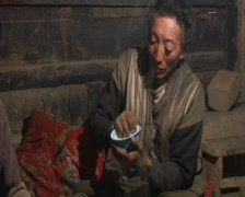 Tibetan man making food Stock Footage