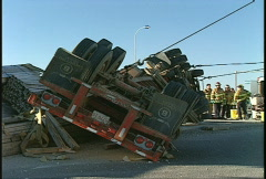 Auto accident, rolled truck trailer partly righted Stock Footage