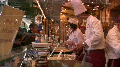 Germany Munich Pancake making Christmas market fair Stock Footage