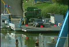 Cable ferry crossing prairie river Stock Footage
