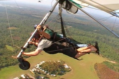 Hang Glider Passes Another Mid-Flight Aerial Hang Gliding Stock Footage