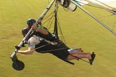 Tandem Hang Glider Lands Gliding Extreme Sport Stock Footage