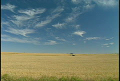 Agriculture, harvest field  pumpjack and sky Stock Footage