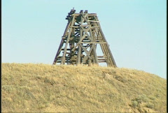 Pan of badlands tipple mine zoom back Stock Footage