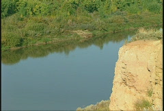 Calm river and cliff face Stock Footage