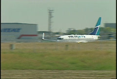 aircraft, westjet Boeing 737-800 take off - stock footage