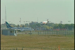 Aircraft, CRJ 100 landing in front of Boeing 737,  long lens Stock Footage
