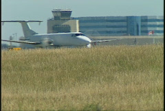 Aircraft, Beech 1900 pass in front of terminal, YYC Stock Footage