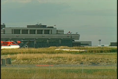 Aircraft, twin Otter taxi, terminal in background Stock Footage