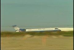 Aircraft, United CRJ-100 take off, follow Stock Footage