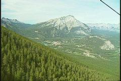 Gondola ride down side of mountain Stock Footage