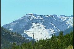 Kananaskis Country snowy ridge zoom back Stock Footage