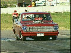 Motorsports, drag race, Chev nova promod burnout Stock Footage