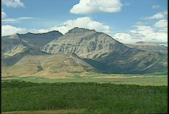 Waterton gap clouds on mtn Stock Footage