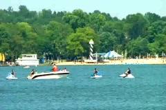 Ski Boat and Jet Skis on Lake Stock Footage
