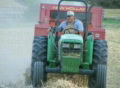 Farmer Baling Hay SD Footage