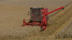 Harvesting machine in field Stock Footage