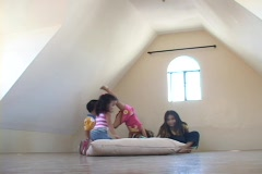 -Cildren playing at attic Stock Footage