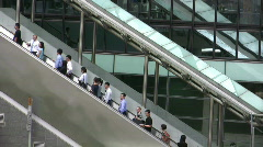 China Hong Kong financial district commuters pedestrians on escalator Stock Footage