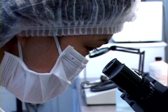 Scientist  looking trought the microscope  Stock Footage