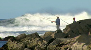 Stock Video Footage of Rock Fishing in Large Surf