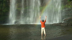 Man and tropical waterfall with rainbow Stock Footage