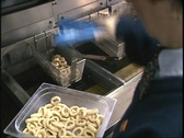 Deep frying onion rings (clip 2 of 4) Stock Footage