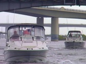 Stock Video Footage of Boats Traveling Under a Bridge River
