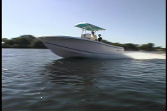 Boat Speeds by Dock Fishing Yacht Boating Marine Watercraft River Sea Lake Wake - stock footage