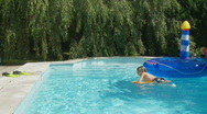 Girl jumping in pool slo mo Stock Footage