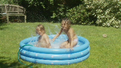 Kids jumping in wading pool slo mo Stock Footage