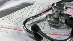 Stethoscope and patient charts. Medical equipment and records. Stock Footage