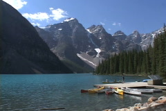 Moraine Lake canoes push in Stock Footage