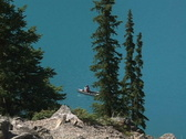 Moraine Lake CU canoe in trees Stock Footage