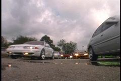 Street Cars Leaving Parking Lot Stock Footage