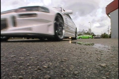 Street Cars Sweep by in a Figure Eight Custom Cars Hot Rods Stock Footage