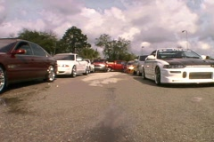 Modified Street Racers in a Parking Lot Custom Cars Hot Rods Stock Footage