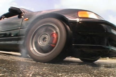 Car Tire Doing A Burn Out Ripping Out Rubber Smoking Tires Peel  Stock Footage