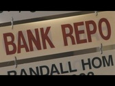 Stock Video Footage of Bank Repo Sign
