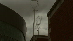 Vertical axis wind turbine against a stormy sky Stock Footage