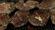 Grilling rib eye steak with juices  Stock Footage