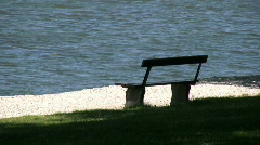 Empty wooden bench next to the ocean Stock Footage