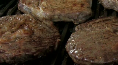 Juicy rib eye steaks cooking on the grill Stock Footage
