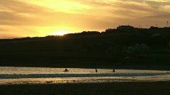 Surfing at sunset Stock Footage