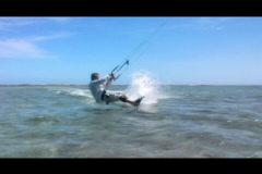 Kitesurfer in the air board grab Stock Footage