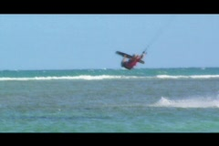 Hot Blonde Kitesurfing Chick trick - stock footage