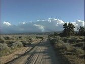 Stock Video Footage of  Desert road with clouds CA